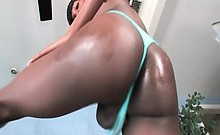Black shemale Tameka strips and teases