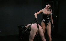 Busty mistress spanking dude
